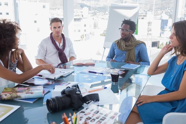 Team of photo editors brainstorming