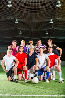 Team playing football or soccer sport indoor