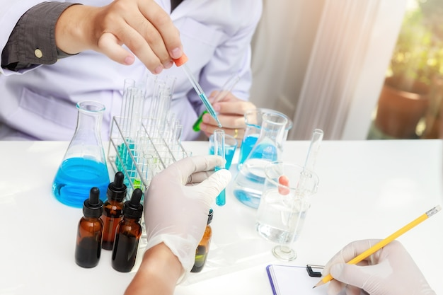 Team of researcher or scientists working in laboratory.