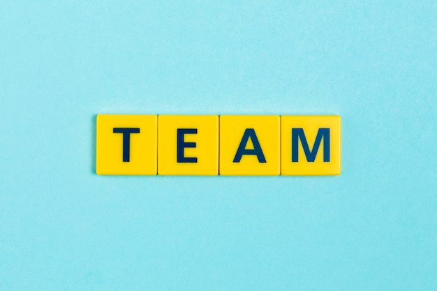 Team word on scrabble tiles