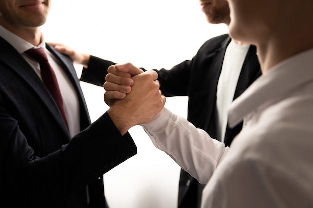 Team work, business people shaking hands