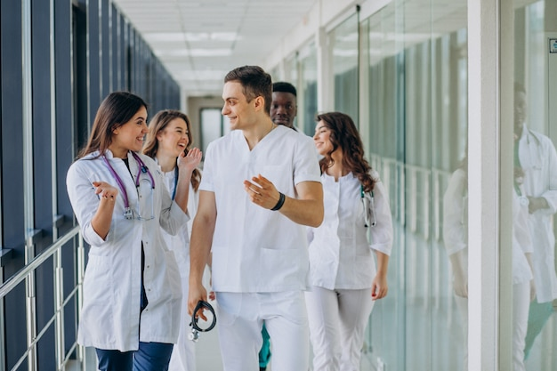 Team of young specialist doctors standing in the corridor of the hospital