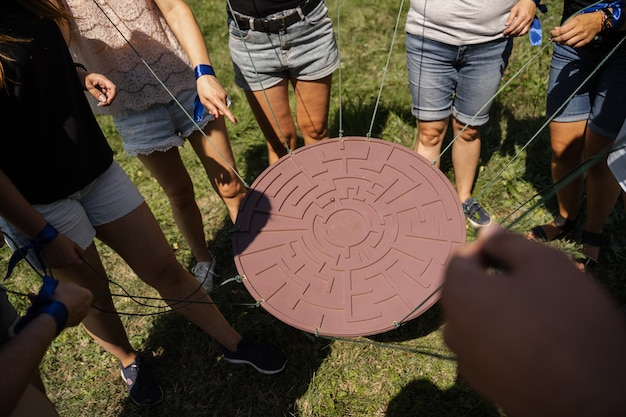 Teambuilding game for group of people for getting team spirit and increase friendship for colleagues. labyrinth game for group of people