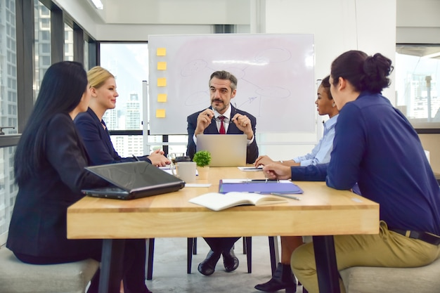 Teamwork business meeting work group for marketing plan success