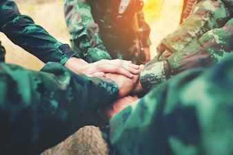 Teamwork Concept : Group of Soldier Hands Together Cross Processing ready to fight.