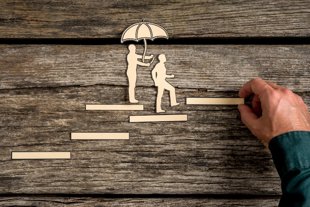 Teamwork concept with cut outs of two men