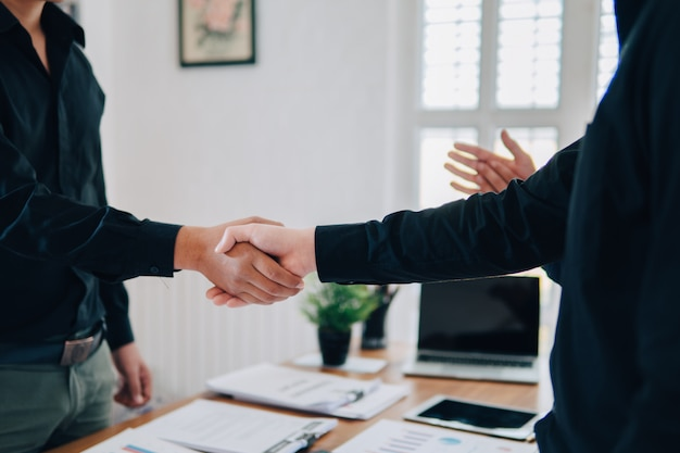 Teamwork join hands partnership third party, business clasping hand and shank hand concept