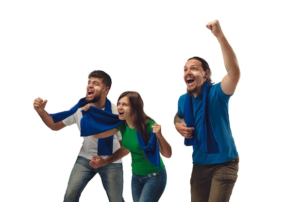 Teamwork and win. female and male soccer fans cheering for favourite sport team with bright emotions isolated on white studio background. looking excited, supporting. concept of sport, fun, support.