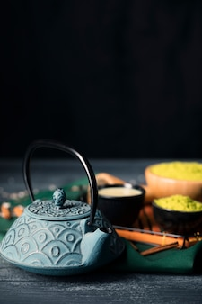 Teapot and beverages on tray high angle