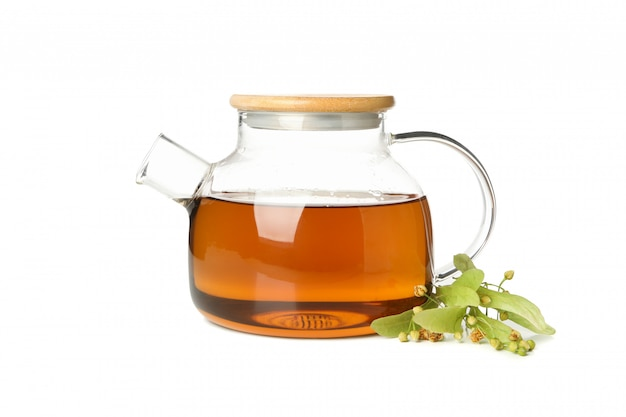 Teapot and linden isolated on white