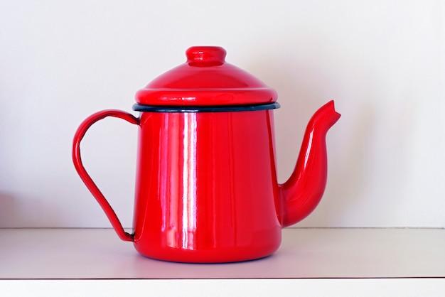 Teapot in red enamel