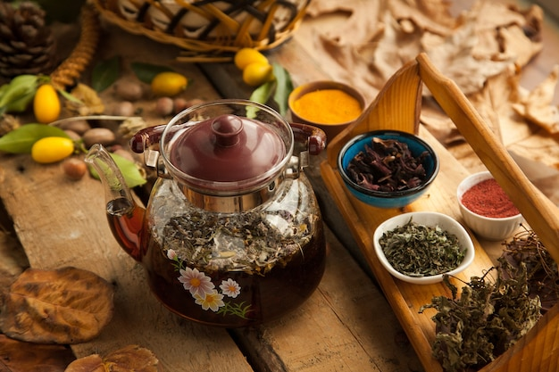 Teapot with carnation and cardamom. autumn warming drink with lemon, anise, cinnamon, cloves and cardamom.