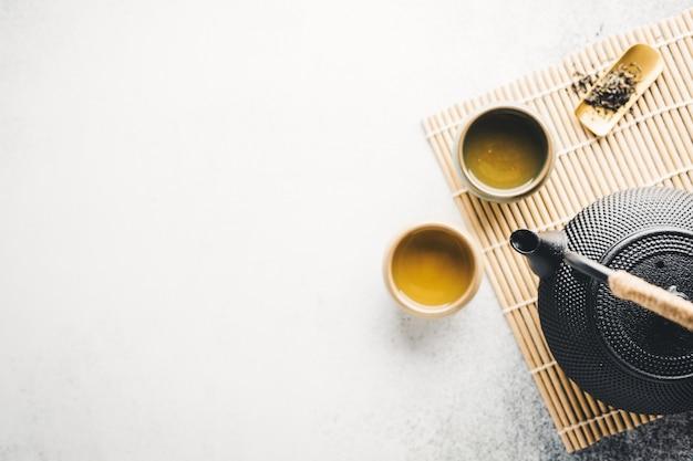 Teapot with tea on bright