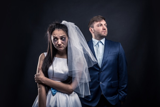 Tear-stained bride and brutal groom in suit