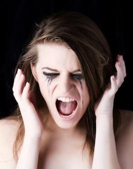 Tearful woman screaming