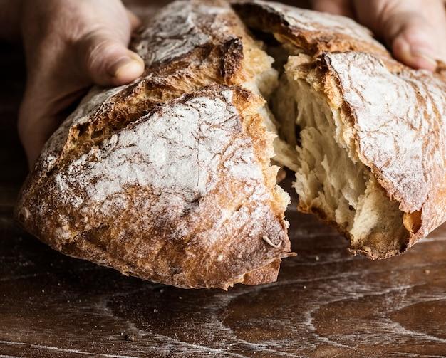 Tearing a bread loaf photography recipe idea