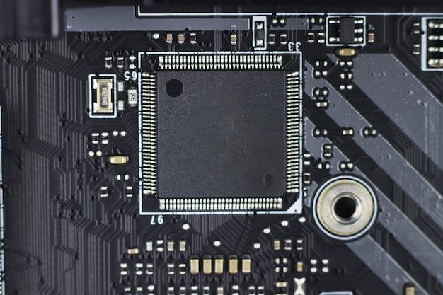 기술 과학 배경입니다. 현대 컴퓨터 회로 기판 컴퓨터 마더보드의 일부입니다. 현대 기술을 나타내는 전자 회로 기판의 매크로 샷