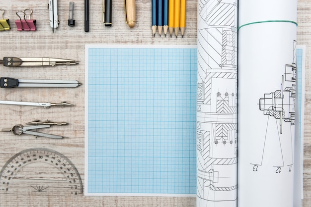 Technical drawing with millimeter paper and drawing tools