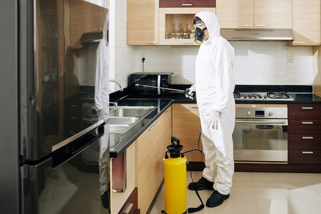 Technician cleaning kitchen