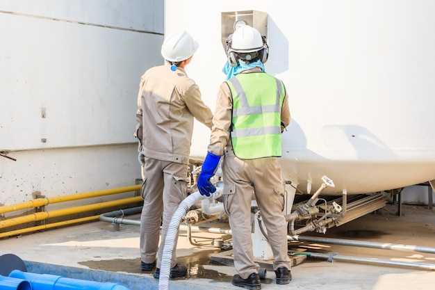 Technician fill with liquid nitrogen with nitrogen storage tank at new factory