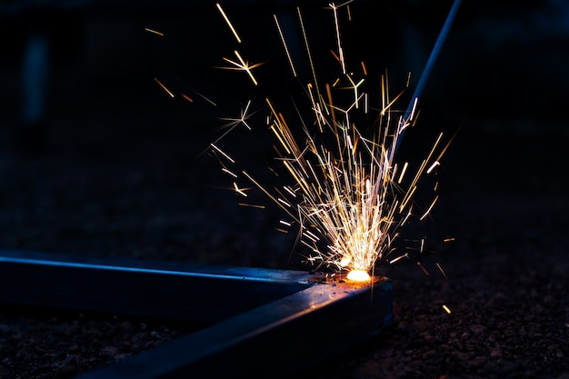 Technician focus on welding process on spark light with equipment.