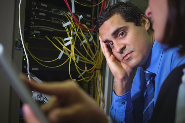 Technician getting bored while analyzing server