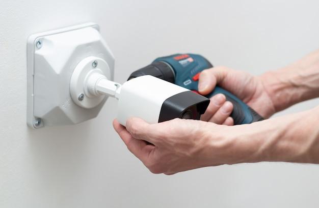 Technician installing cctv camera video security