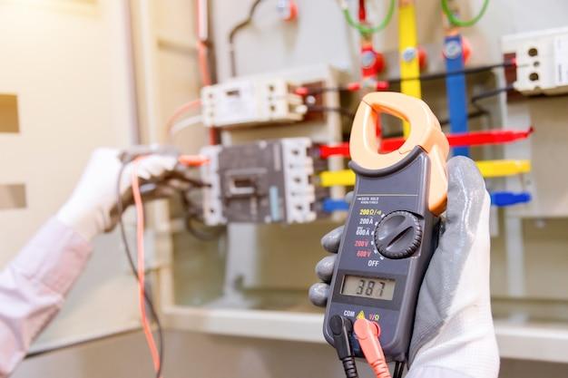 Technician is measuring voltage .