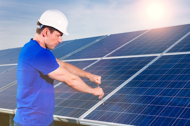 Technician maintaining  solar panels
