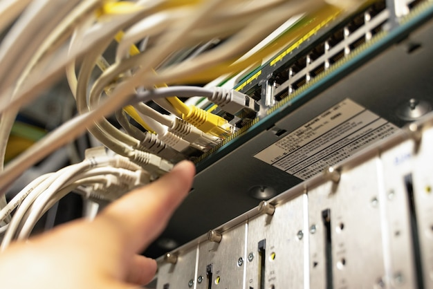 Technician pointing at cables in cables room