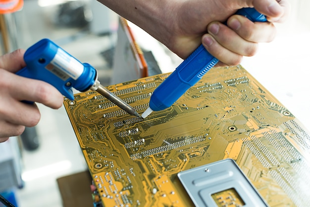 Technician repaired mother board
