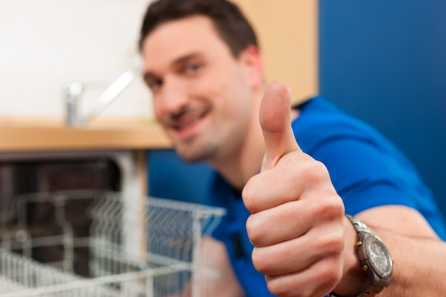 Technician repairing the dishwasher