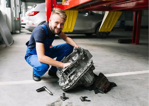 Technician repairing engine