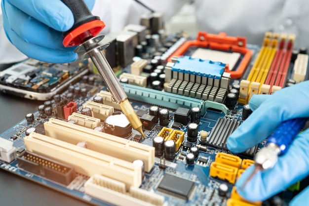 Technician repairing inside of hard disk by soldering iron