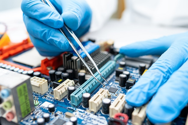 Technician repairing inside of hard disk.