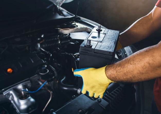 Technician replaced new battery of the car