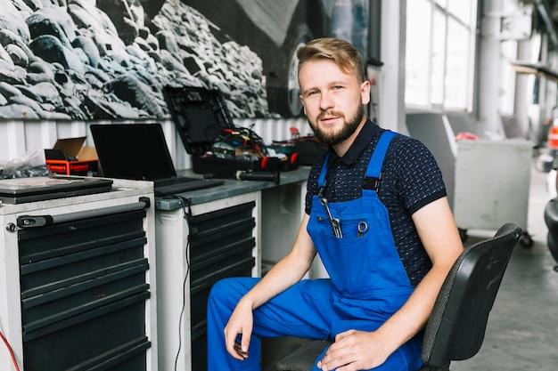 Technician sitting at workbench