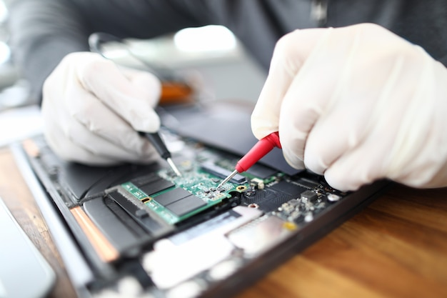 Technician soldering laptop board