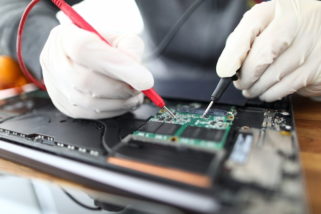 Technician soldering laptop parts