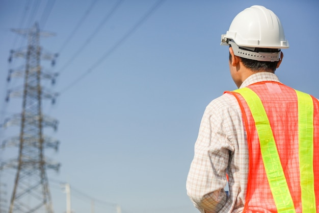 Technician with white helmet inspect high voltage power station