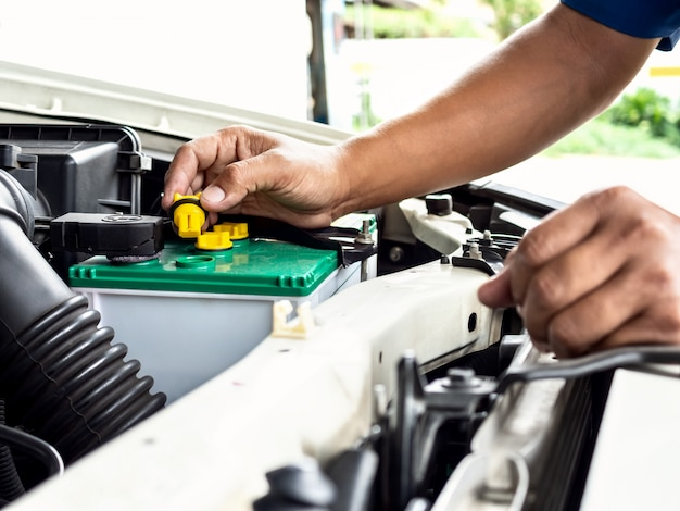 Technician work in car auto service