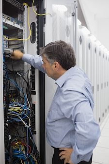 Technician working on a case of server racks