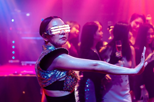 Techno dancer in night club dancing to the beat of music from dj