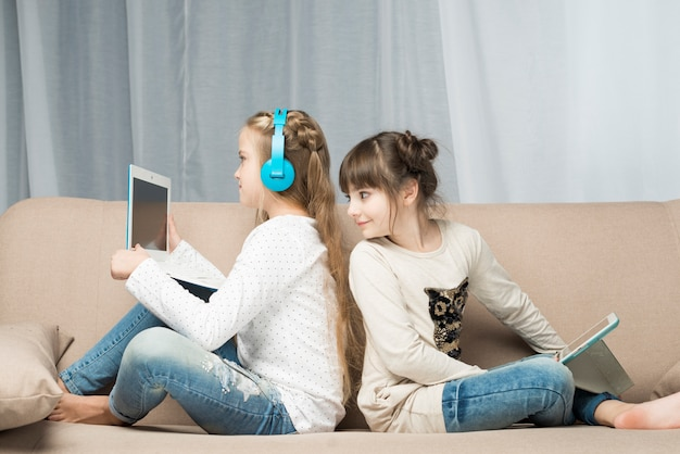 Technology concept with girls on couch