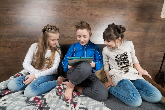 Technology concept with three kids