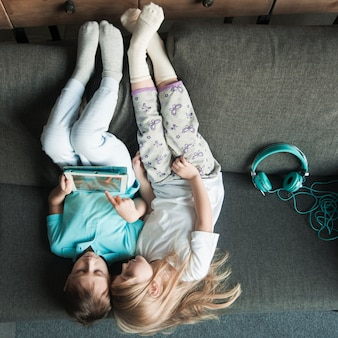 Technology concept with two girl playing with tablet
