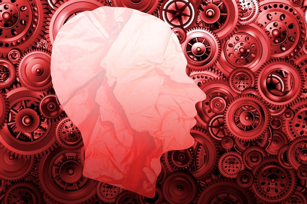 Technology development and training concept. silhouette of a man's head from crumpled paper on a background of various mechanisms. gears in motion. concept for design. 3d image.