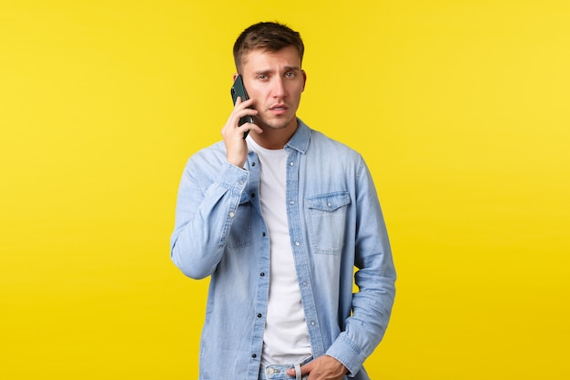 Technology lifestyle and advertisement concept busy seriouslooking man in casual clothes having impo...