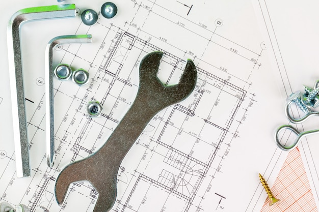 Technology and metalworking. metal bolt and nut on blueprint