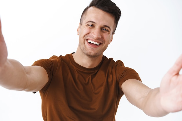 Technology, online lifestyle and quarantine concept. happy cheerful adult man videochat with friends during covid19 pandemic, stay home and stay in touch with world using internet, taking selfie